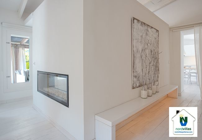 Modern fireplace in the wall of Villa Casa Blanca